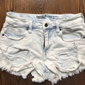 Distressed high rise jean short